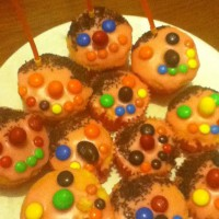 Cupcake faces with orange icing