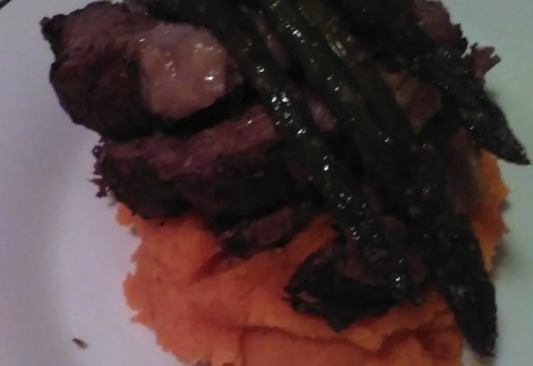 Garlic and rosemary lamb roast with mashed kumara and asparagus