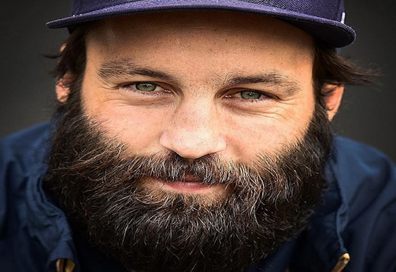 Football star shaves off beard he's been growing for charity