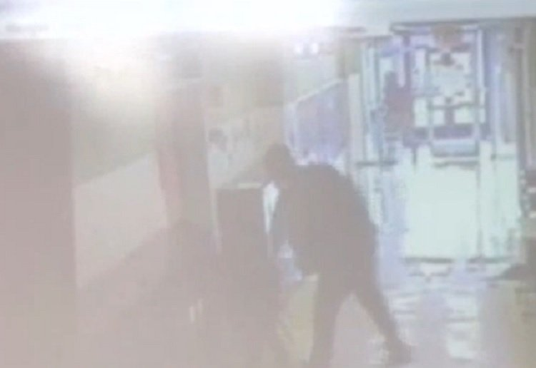 The moment a man punched a little boy in the school hallway