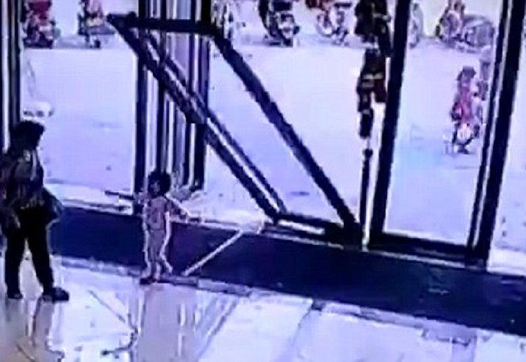 MIRACLE: Horror footage as glass door crashes down on three-year-old