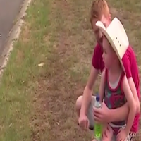 Little boy looking after the fireman in NSW