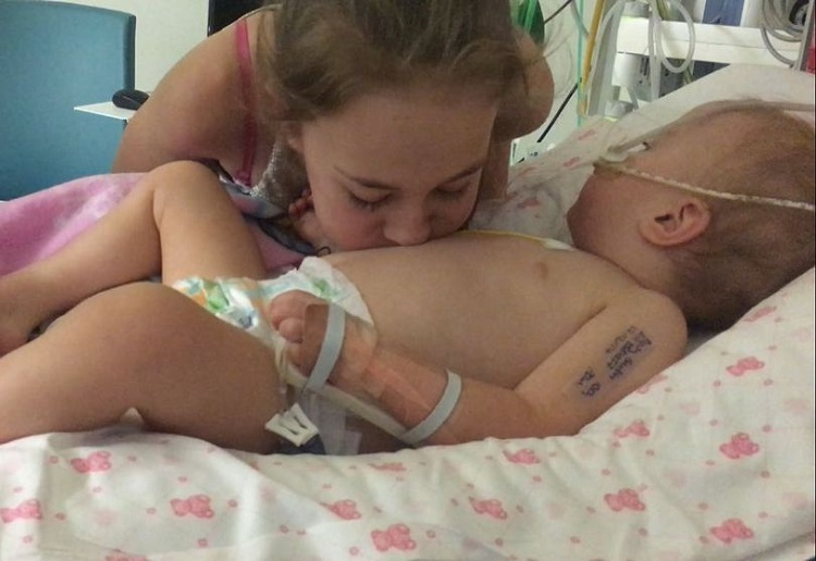 Baby wakes from coma after big sister blew a raspberry on her
