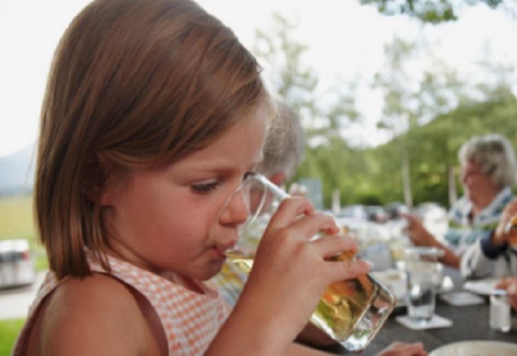 Children left 'vomiting blood' after drinking contaminated juice
