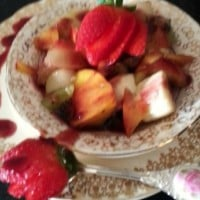 Fresh fruit salad with berry coulis