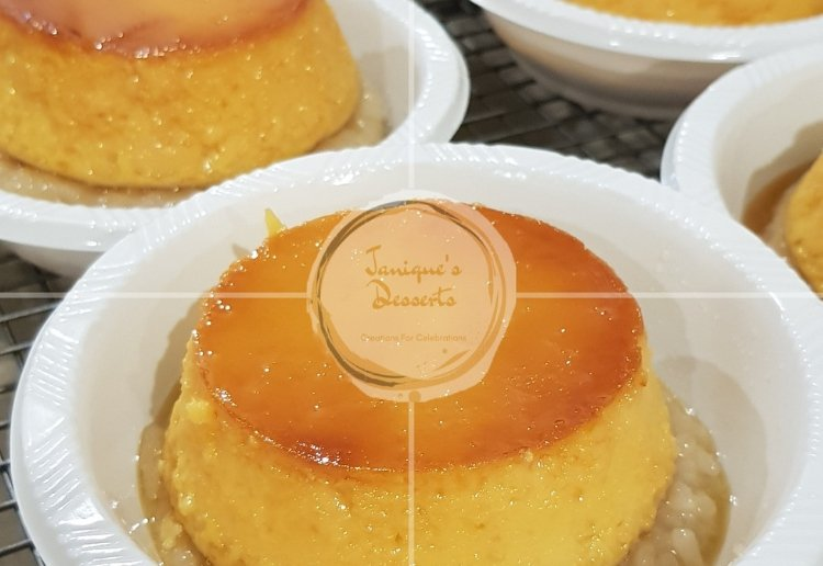 A Yellow and Gold Sweet Rice Cake with Egg Custard sitting on top